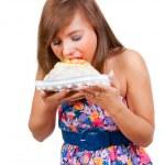 Girl eat cake — Stock Photo