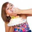 Girl eating cake with his hands — Stock Photo #11464068