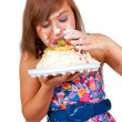 Girl eating cake with his hands — Stock Photo