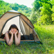 Young woman resting in a tent — Stock Photo