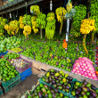 Many tropical fruits in outdoor market - Stock Photo