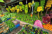 Many tropical fruits in outdoor market — Stock Photo