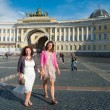 Two young women walking on Palace Square — Stock Photo