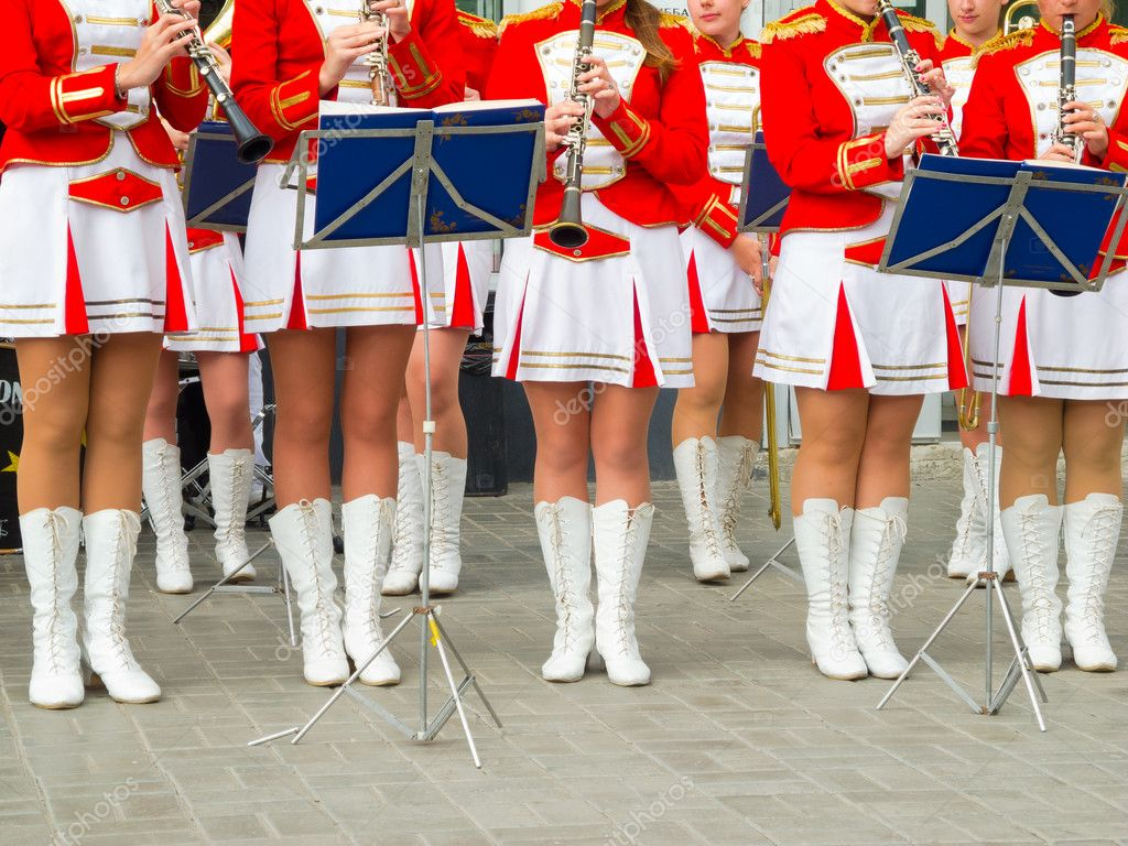 Girl Brass Band in red uniform performing — Stock Photo #12133675
