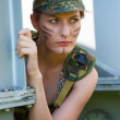 Portrait of young woman in military camouflage — Stock Photo