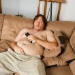 Fat guy sleeping on the couch — Stock Photo