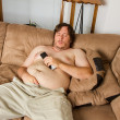 Fat guy sleeping on the couch — Stock Photo #12122682
