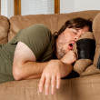 Stock Photo: Mtaking quick nap on couch