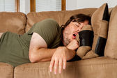 Man taking a quick nap on the couch — Stock Photo