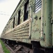 Stock Photo: Old thrown train cars