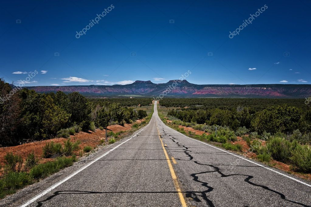 Image of a long desolate road leading off into a plateau  Stock Photo #10908913