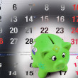 Stock Photo: Piggy Bank on Calendar Pages