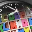 Stock Photo: Alphabets and Clock