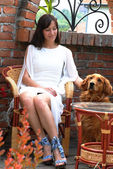 Young woman and a dog — Stock Photo