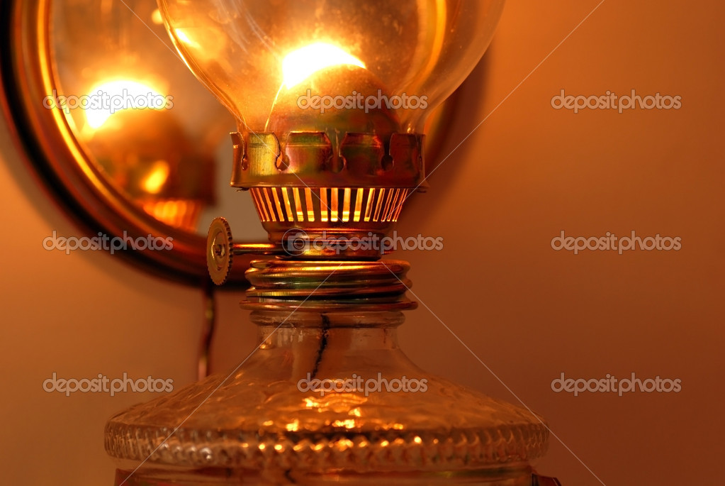 Lit golden kerosene lamp details closeup macro — Photo #12387274