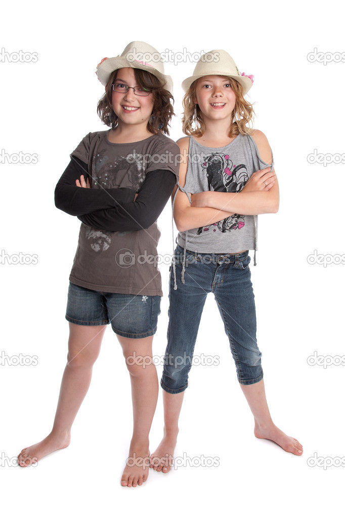 Two girls standing in front of a white background — Stock Photo #10983982