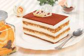 Tiramisu cake and silver spoon — Stock Photo