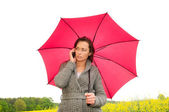 Angry young woman with mobile phone — Stockfoto