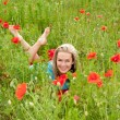 Womlying in poppy field — Stock Photo #11639032