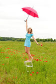 Woman with red umbrella — Stock Photo