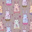 Seamless pattern with rabbits — Stock Vector #12222595