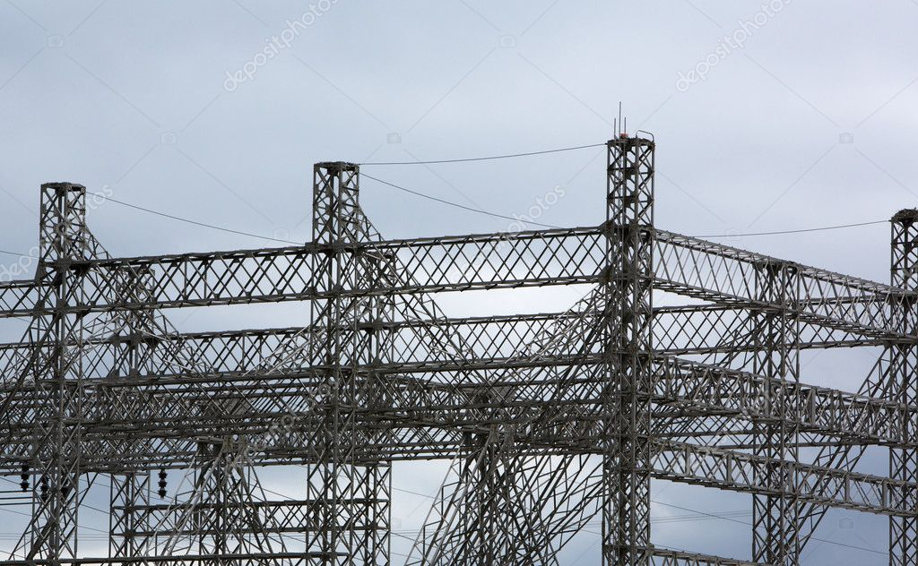 Complex steel structure of electrical power grid against cloudy sky — Stock Photo #11838581