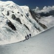 Climbers in alps - Stock Photo