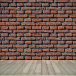 Brick wall and wooden floor — Stock Photo #12322749