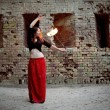 Young Girl Twisting Burning Poi — Stock Photo