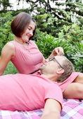Woman Fondling Man on Picnic — Stock Photo