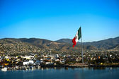 Port of Ensenada and Mexican flag — Stock Photo