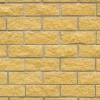 Photo: Brick wall of yellow stone