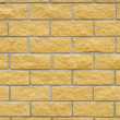 ストック写真: Brick wall of yellow stone