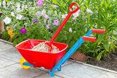 Garden wheelbarrow with sand — Stock Photo