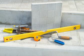 Paving slabs and tools for laying tiles — Stock Photo