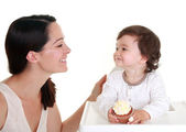Baby with cupcake — Stock Photo