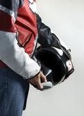 Motorcycle biker with helmet — Stock Photo