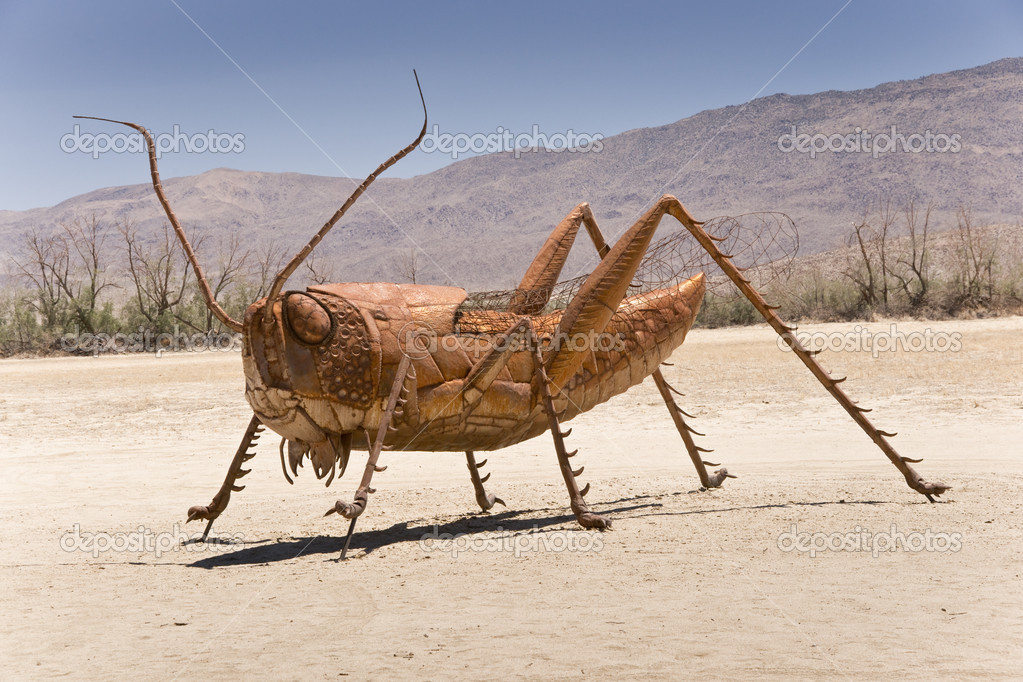Metal sculpture of a prehistoric grasshopper — Stock Photo #11412657