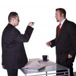 Постер, плакат: Businessmen Fighting Across the Desk