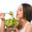 Young woman eating healthy salad — Stock Photo #10772082