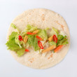 Fresh vegetables on tortilla — Stock Photo