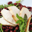 Royalty-Free Stock Photo: Chicken breast with red beans and arugula