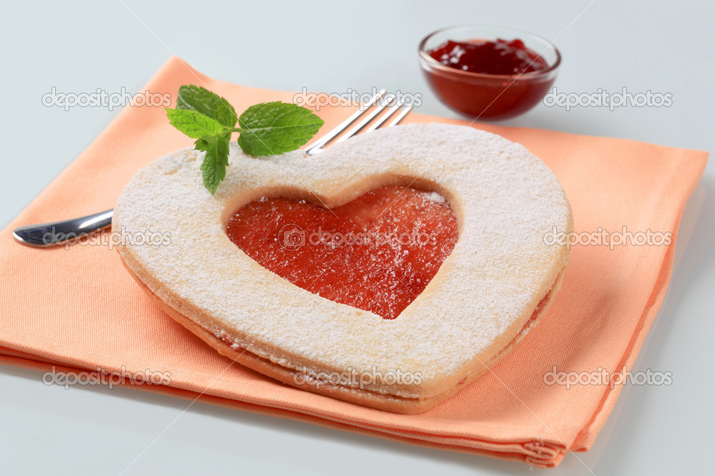 Heart shaped shortbread cookie with jam filling — Stock Photo #11451836