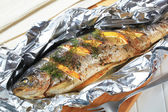 Baked trout with lemon and dill — Stock Photo
