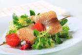 Fish skewer and salad greens — Stock Photo