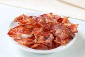 Gevrek domuz pastırması şeritler — Stok fotoğraf