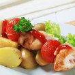 Chicken skewer with potatoes — Stock Photo
