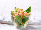 Shrimps with salad greens — Stock Photo
