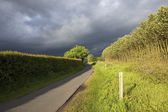 Summer storm clouds over landscape — Stock Photo