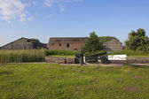 Canal lock and barns — Stock Photo